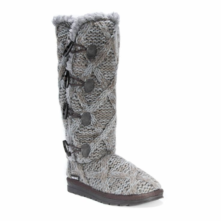 Step out into the snow knowing your feet are warm in these fashionable grey boots. Crafted of polyester, these boots have a sweater-like appearance with buttons for an added touch with an inner lining