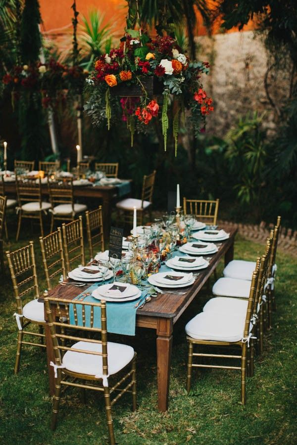 Festive wedding reception table decor | Image by Blest Studios