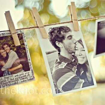 clothes line pics of the happy couple..might do this with black & white photos & silver glitter clothes pins from Michaels