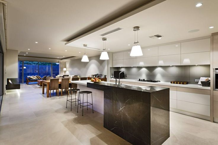 Love this kitchen design - using both engineered & natural stone enables the space to be functional & stunning!
