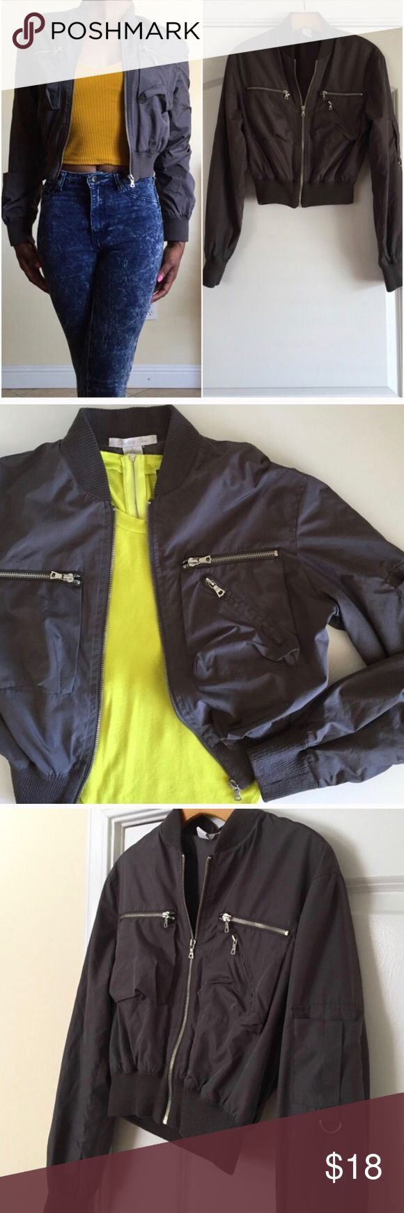 Gray Cropped Bomber Jacket Gray Bomber with silver zip up pockets. Junior fit with cropped style. Pockets on the chest that zip up. D ring k pocket on the arm. Light weight jacket. Like new condition. Wet Seal Jackets & Coats Utility Jackets