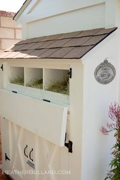 Chicken Coop - drop down egg door with storage below ..I like the idea of being able to access the eggs without going into the coop, & I would still put dollar store plastic tubs inside each nesting box for easy cleaning.