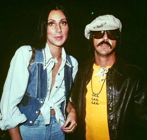 Cher with her husband, Sonny Bono, who looks very goofy here. Notice the ring in Cher's nose.