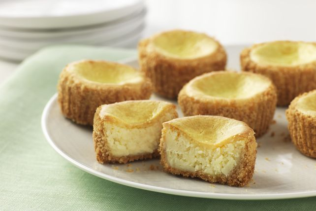 With vanilla wafer crusts and lemony cream cheese fillings, these mini cheesecakes baked in muffin cups are delightful dessert treats.
