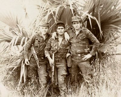 Cuban soldier poses with a pair of Soviet Marines somewhere in the suburbs of Luanda. Photo taken sometime during 1982.