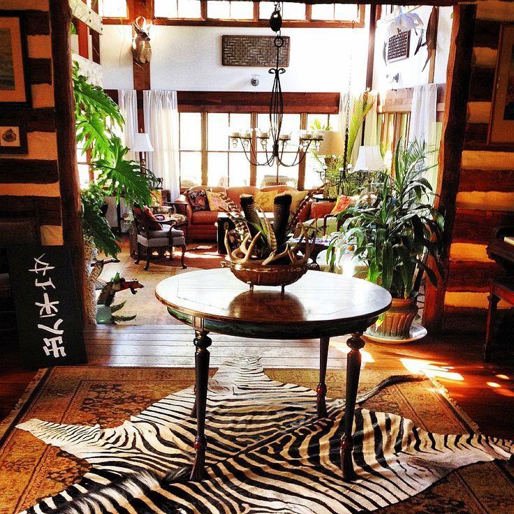 Zebra hide rug gives the room an