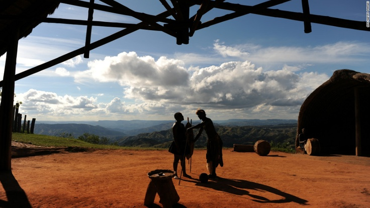 Zulu Kingdom travel guide: Valley of 1,000 hills -- Members of South Africa's Zulu tribe dance on top of the famous Valley of a Thousand Hills on the outskirts of Durban. The area is named after the hills that tumble down to the Umgeni River.