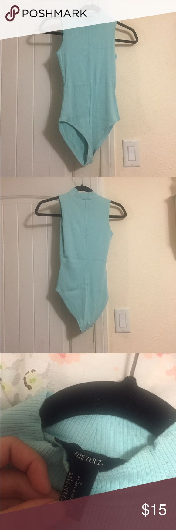 Baby blue bodysuit💙 Forever 21 baby blue bodysuit. Worn once for a photoshoot. Sleeveless and mock neck Forever 21 Other
