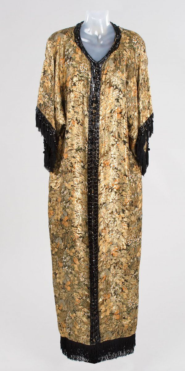 Marilyn Monroe dressing room robe by Travilla. This stunning dressing room robe was worn by Marilyn Monroe and designed by Bill Travilla. Made of black and gold brocade in a floral motif and embellished with jet black beads along the front closure and collar as well as the sleeve. Silk lined. Internal Travilla label.