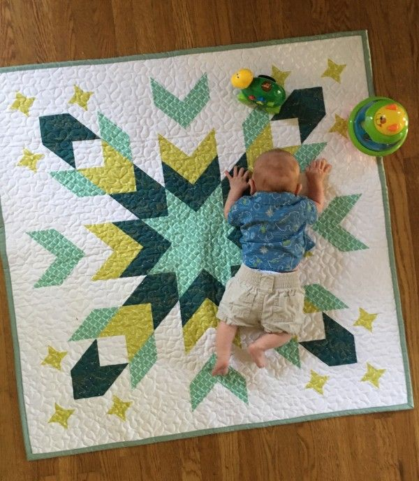Starburst Geometric Design Baby Quilt in Green