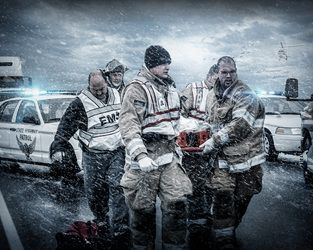 Emergency medical services composite/montage featuring ems personnel, life flight helicopter and police car in a stormy, snow filled accident scene background.