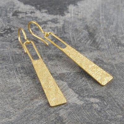 Hammered Grecian Long Drop Gold Earrings - These stunning Hammered Grecian Long Drop Gold Earrings have a unique textured surface and the design is reminsicenst to us of the jewellery of classical antiquity. Contemporary designer earrings inspired by ancient civilisation. #Otisjaxon #Jewellery