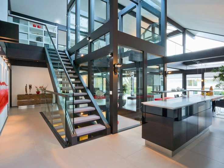 Huf Haus - steal Staircase surrounding glass centre