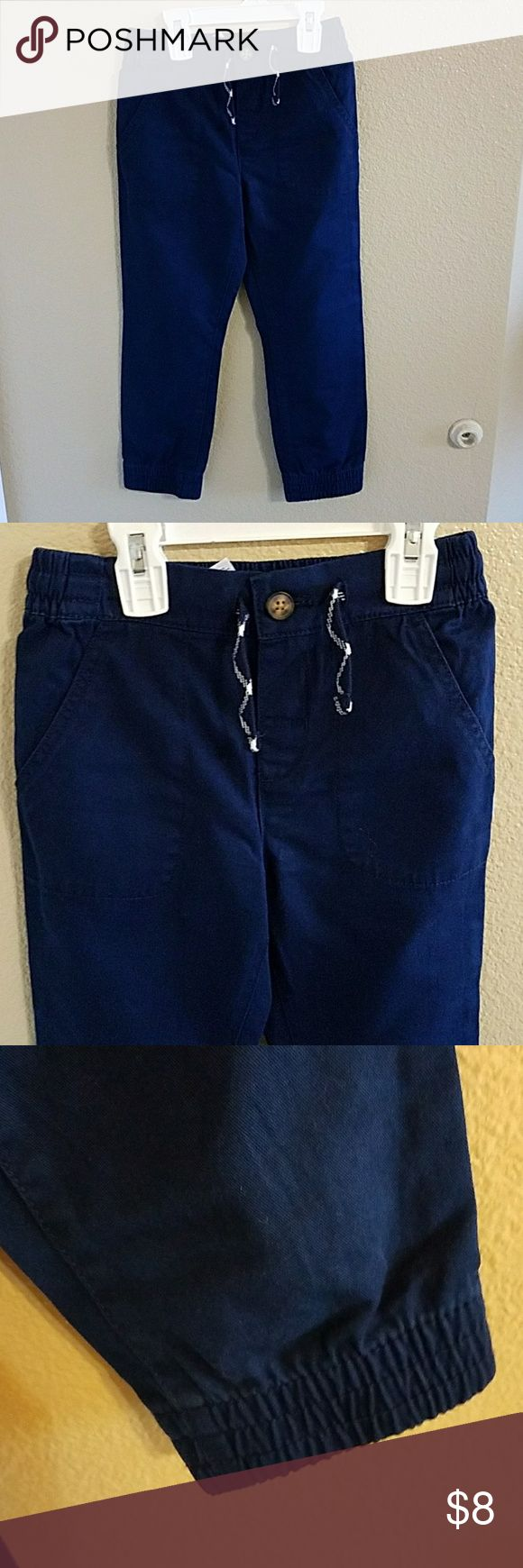 Carter's NWT Navy Blue Boys Pants size 6 NWT Carter's Navy Blue Boys Jogger Pants 2 pockets in front and on back. Elastic hem around ankles, button waist with drawstrings for a comfy adjustable fit. Carter's Bottoms