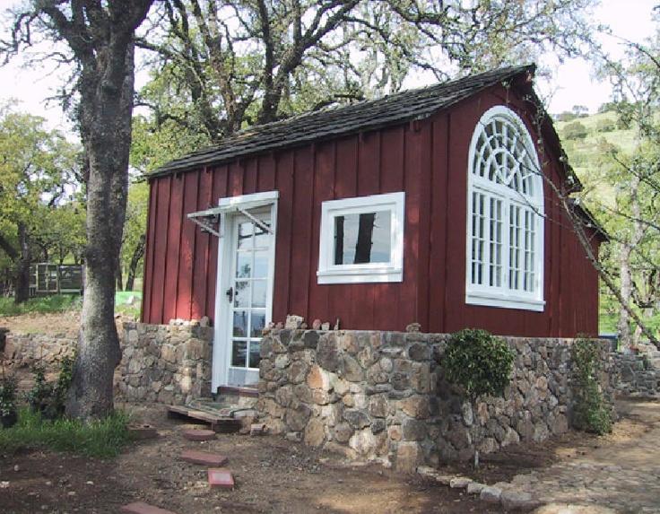 Tiny red stone Aussie cabin
