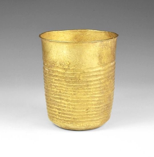 Achaemenid Gold Ribbed Cup, 6th-4th Century BCThe closest parallels to this cup are similar shaped cups that have been adapted into rhyton vessels by the addition of an animal shaped spout. The ridged...