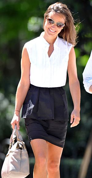 The stylish traveler was out and about in Madrid wearing a sleeveless white blouse tucked into a black peplum skirt.