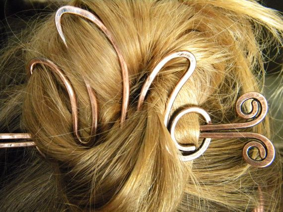 Slide shown in hair wrapped into a loose bun and flipped out the top. This Slide works best as a cup for holding hair done up in curls or a bun.
