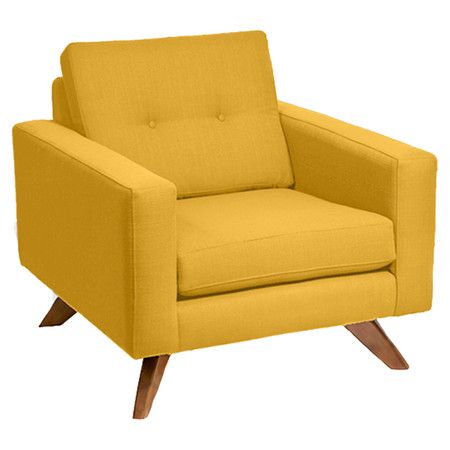 Midcentury-inspired arm chair with mustard-hued linen upholstery and a button-tufted back cushion. Made in the USA.    Product:
