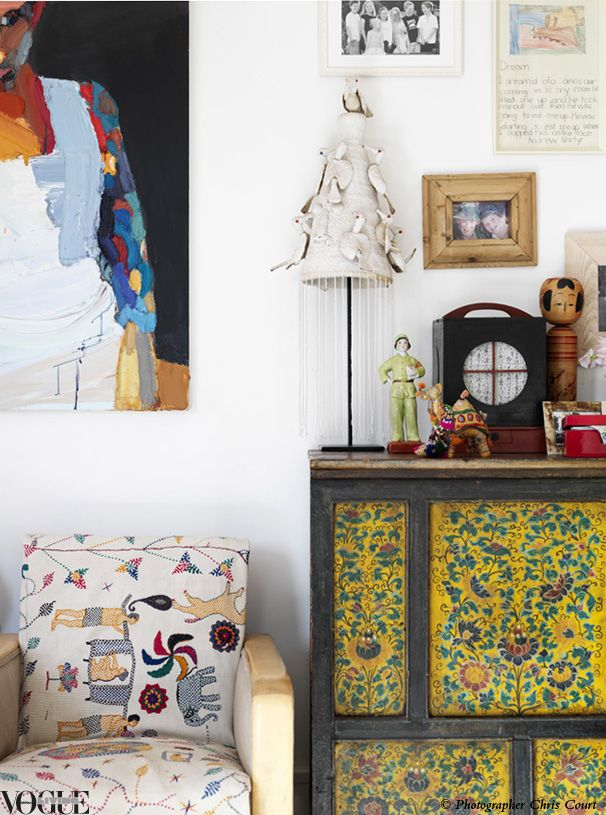 antique, vintage console table with yellow, colorful art, side chair, bohemian, eclectic