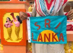 "jackiebarry:  "" Elizabeth's friend Zaluja holding the flag I made for Elizabeth's Sri Lankan adventure.  """
