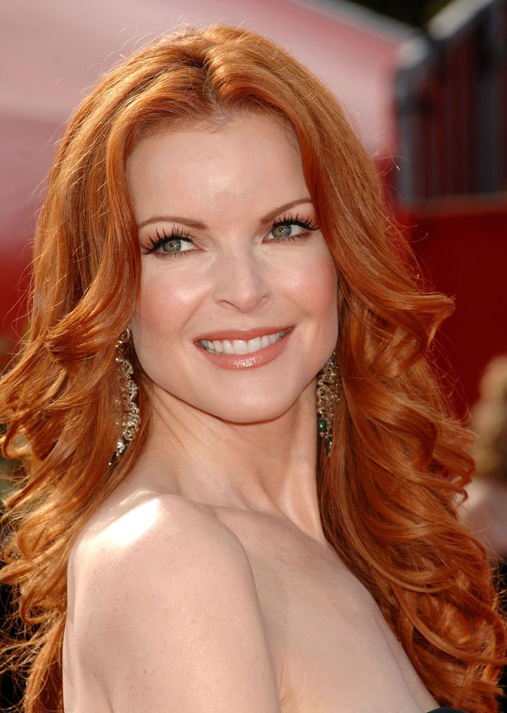 Marcia Cross long curly hairstyle for women over 50