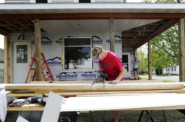 Tony Albrecht of Winona measures and cuts soffit while he works on his porch with his fiance Allison Grupa on Sunday, April 15, 2012, in Winona. (Alexa Wallick/Winona Daily News)