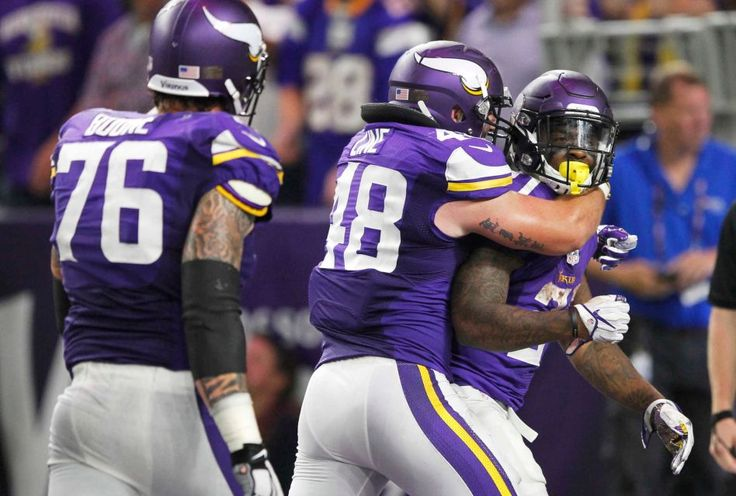 Monday Night Football: Giants vs. Vikings:   October 3, 2016  -  24 - 10, Vikings  -    Minnesota Vikings running back Jerick McKinnon, right, celebrates with teammates Zach Line, center, and Alex Boone, left, after scoring on a 4-yard touchdown run during the second half of an NFL game against the New York Giants, Monday, Oct. 3, 2016, in Minneapolis.