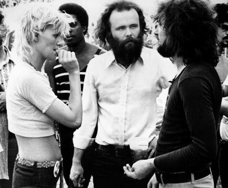 Garth Hudson of The Band chatting with Delaney and Bonnie Bramlett at Midway Stadium in St. Paul, Minnesota in 1970. (Photographer: Michael Ochs)
