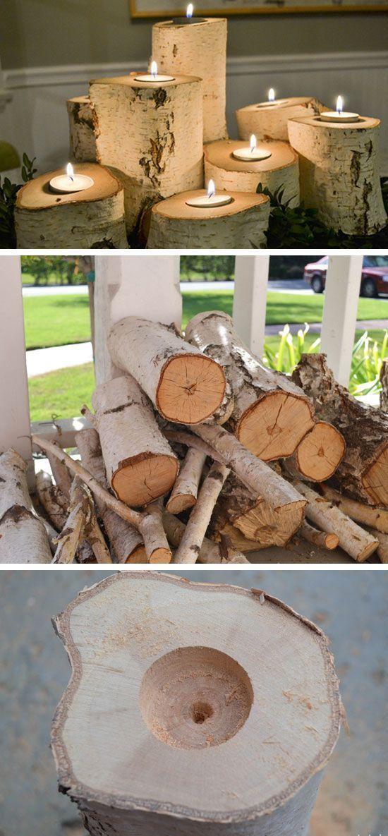 Portes bougies avec des bûches de bois