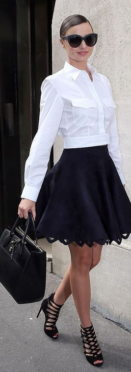 Who made  Miranda Kerr's cat sunglasses, leather handbag, white button down shirt, and blue cut out scallop skirt?
