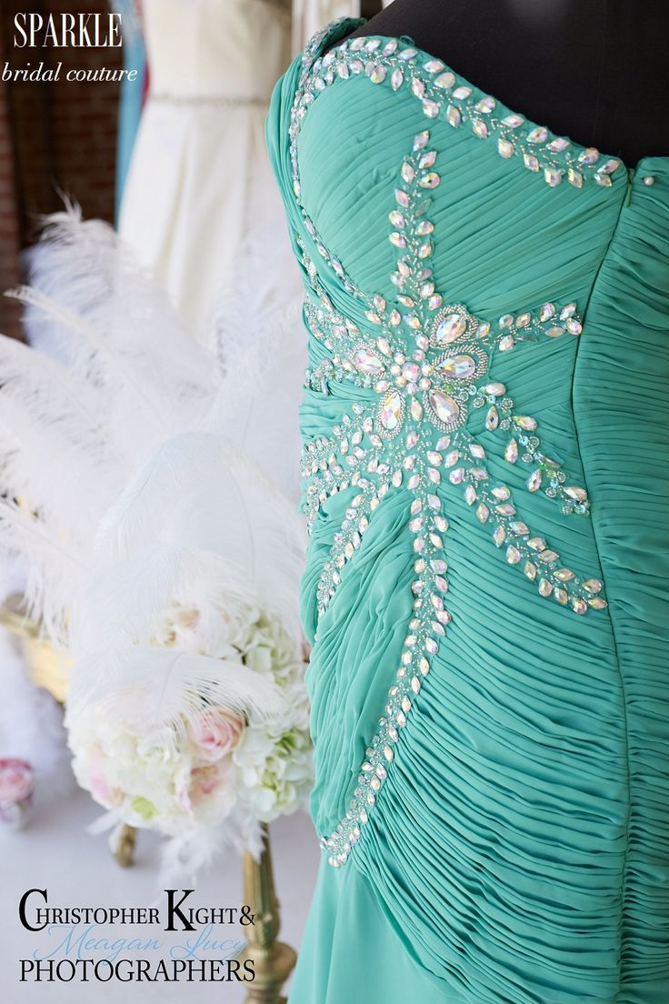This beautiful SPARKLE special occasion dress is this month's centerpiece. The color really brings out the colored glass and floral elements of June's window. come try on this gorgeous gown!  http://simplecountryweddings.com/  http://accentsbysage.com/ Photo By Meagan Lucy http://www.kightphoto.com/meagan-lucy/ #sparklebridal #sparklebridalcouture #christopherkightphotographers #realweddingmagazine #sacramentobride #marieantoinette @simplecountry @accentsbysage