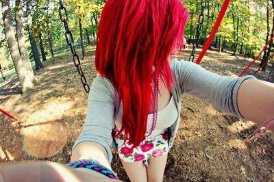Red hair; floral skirt