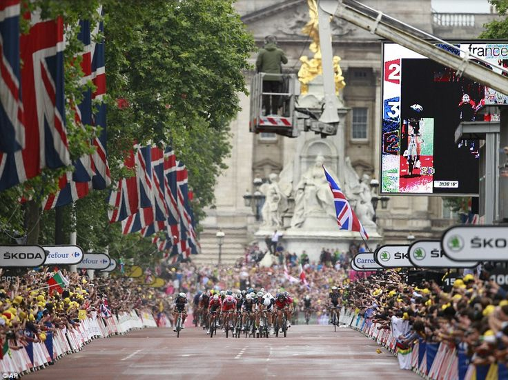 Dramatic finish: The pack with stage winner Marcel Kittel of Germany sprints down The Mall as Buckingham Palace is seen in the background
