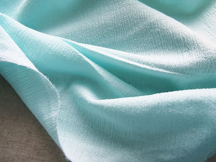 Tissu cr pon couleur turquoise bleu vert pastel 140 50 cm turquoise pastel - Tissus bleu turquoise ...