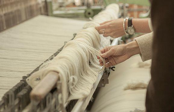 Buyers examining textiles - http://www.norwegian.com/
