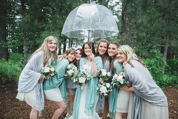 bridesmaids in the rain http://www.weddingchicks.com/2013/10/16/rainy-day-wedding-2/