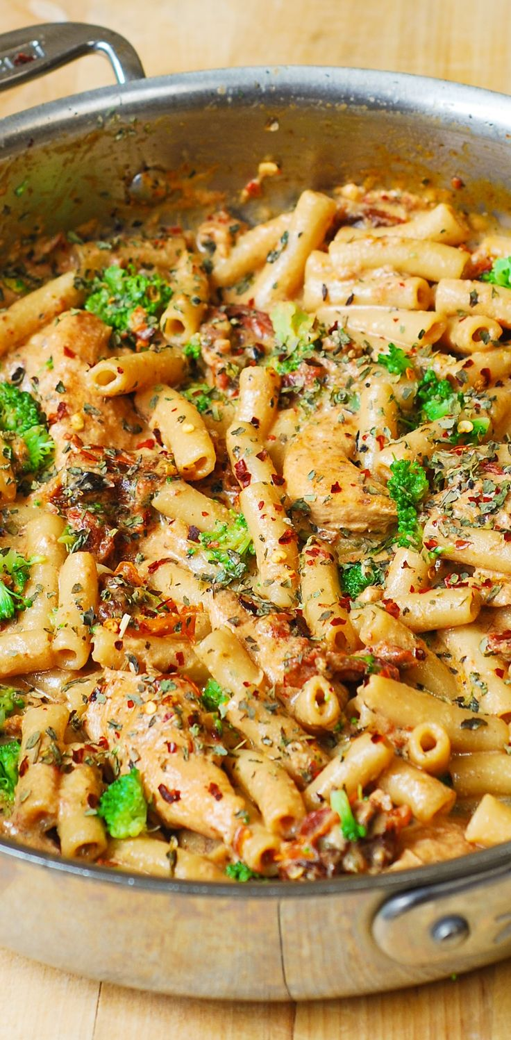 Chicken and Broccoli Pasta with Sun-Dried Tomato Cream Sauce- Short, penne pasta smothered in a flavorful, creamy sauce spiced up with garlic, sun-dried tomatoes, basil and crushed red pepper flakes!