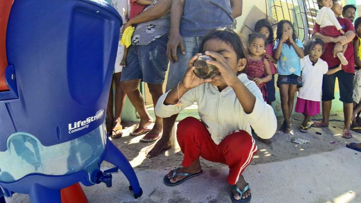 Drinking safe water in the aftermath of Typhoon Haiyan with donations of LifeStraw Community- Rotary Club of Ft Lauderdale and Shelterbox