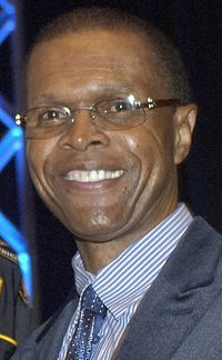 "Gale Eugene Sayers (born May 30, 1943), also known as ""The Kansas Comet"", is a former American college and professional football player who was a running back in the National Football League (NFL) for seven seasons during the 1960s and early 1970s. He played college football for the University of Kansas, and was twice recognized as an All-American. He was a first-round pick in the 1965 NFL Draft, and played his entire pro career for the NFL's Chicago Bears."