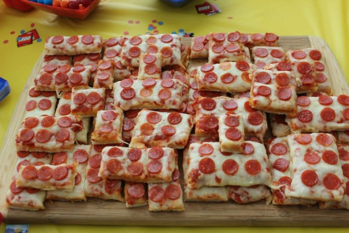 Lego Party - food - Lego pizzas! (I bought frozen cheese pizza and mini pepperoni..cut the pizza into different sized rectangles and added the pepperoni to make them look like legos)