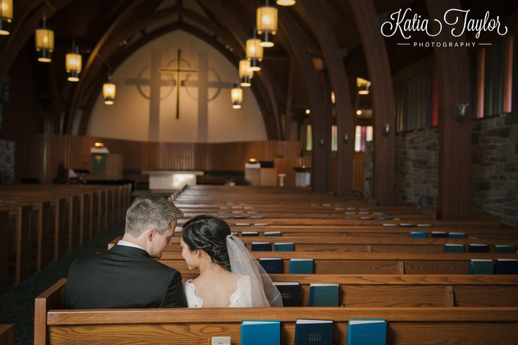Bride and groom share a quiet moment in the church after wedding ceremony. St. Giles Kingsway Presbyterian Church. Toronto.