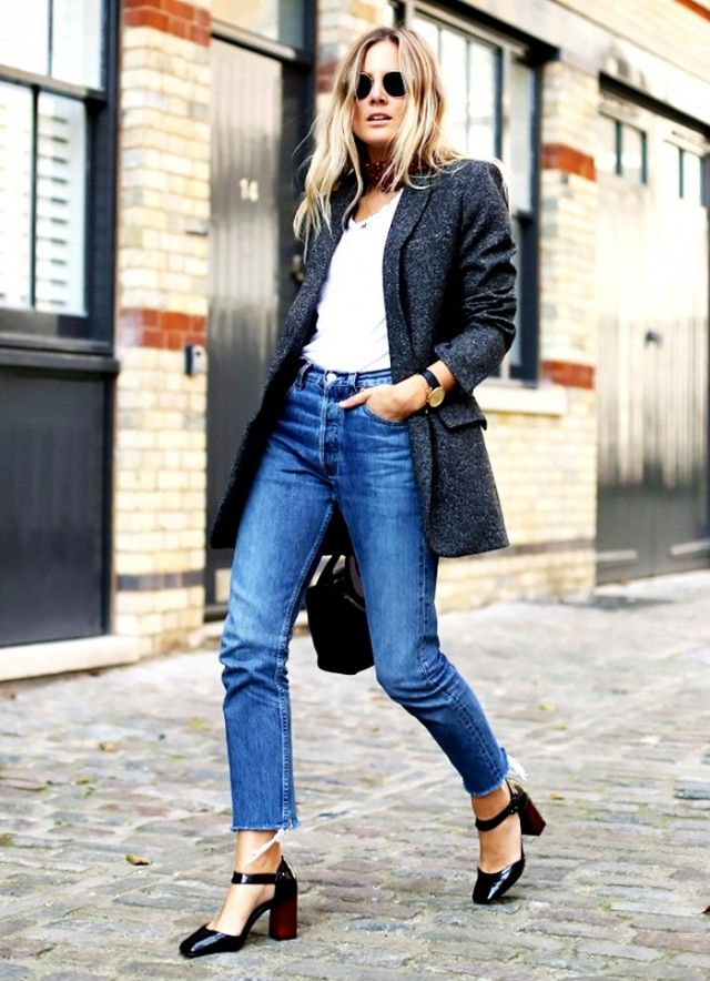 A white t-shirt is worn with a wool blazer, high-waisted jeans, and ankle-strap heels