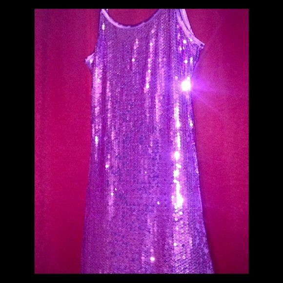 Purple Sequin Dress Beautiful dress! Falls above the knees, sexy while still looking classy. I bought this for a dance and didn't get to go so I never had a chance to wear it. This came from a boutique and I've kept it in my closet just in case but now I'm going to let it go...love this dress! Dresses