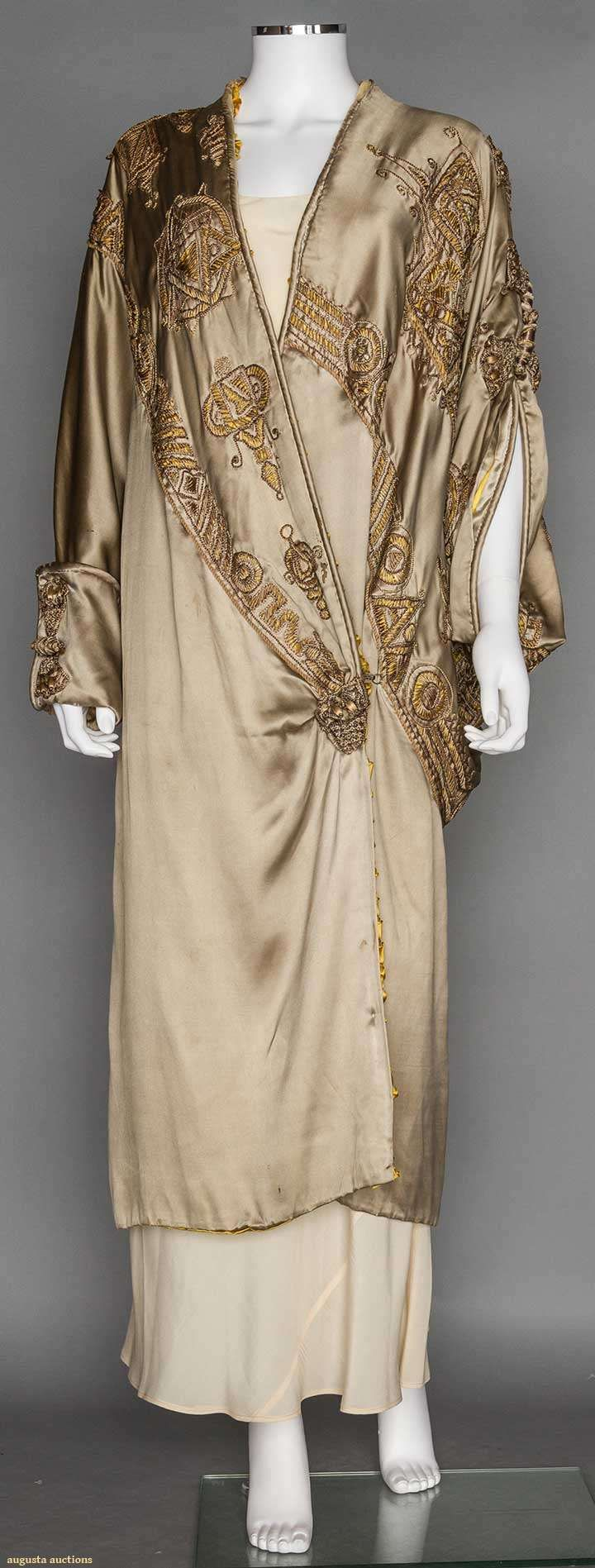Avant Garde Opera Coat 1910-1920 Taupe silk charmeuse trimmed in various gold applique motifs outlined w/ embroidery & taupe soutache, cross over opening, 1 tubular sleeve & 1 cape-like sleeve, gold satin lining,