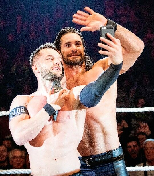 Finn Bálor taking a selfie with Seth Rollins