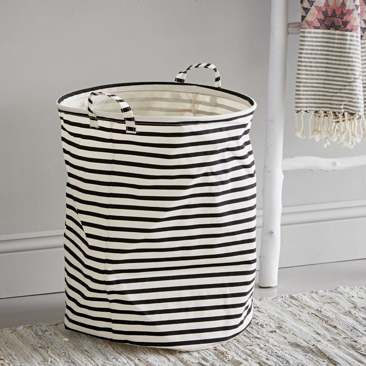 this  black and white striped fabric laundry bin. Organise your dirty laundry in style.  - A House Doctor DK product