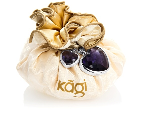 Kagi Golden Pouch Bag teamed with the Enchanted Violet Loyal Pendant