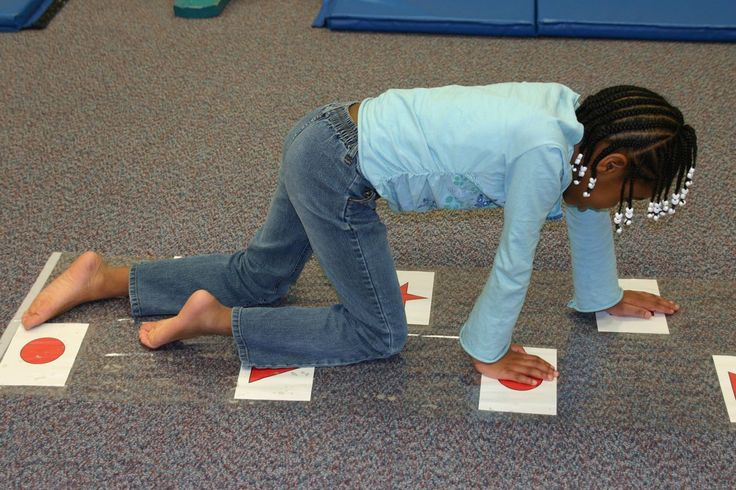 Creeping on the Creep Track to develop balance, depth perception, eye-hand coordination, bilateral coordination and eye teaming. (gross motor)