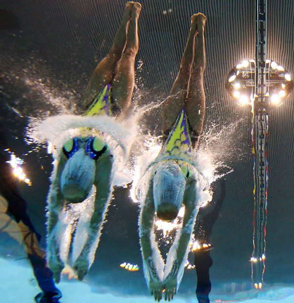 .Ukraine's Daria Iushko and Kseniya Sydorenko are seen underwater as they dive in to perform in the synchronised swimming duets technical routine qualification round - Picture: REUTERS/Michael Dalder